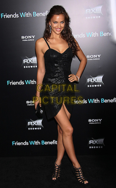"Irina Shayk.The New York Premiere of ""Friends With Benefits"" at the Ziegfeld Theater, New York, NY, USA..July 18th, 2011.full length black dress hand on hip ruched print strappy ankle sandals shoes clutch bag.CAP/LNC/TOM.©LNC/Capital Pictures."