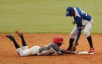 "Major League Baseball prospect Bladimil Matos slides in safely during the five inning at the final game of the ""Torneo Supremo"" at the Quiskeya National Stadium in Santo Domingo. The Tournament which aims to maximize the ability of Major League Baseball organizations to scout in the Dominican Republic. According to the MLB's office in the Dominican Republic, this year, the tournament introduced 23 new baseball prospects. July 29 2011. ViewPress/ Kena Betancur"