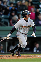 First baseman Mike Ford (26) of the Charleston RiverDogs bats in a game against the Greenville Drive on Wednesday, April 16, 2014, at Fluor Field at the West End in Greenville, South Carolina. Charleston won, 8-7. (Tom Priddy/Four Seam Images)