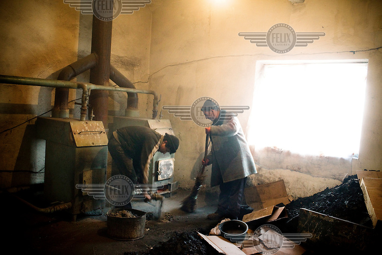 Men tend to the newly renovated heating system at the specialised prison-colony 27, which houses detainees with MDR TB (multi-drug-resistant tuberculosis). Kyrgyzstan's prisons are experiencing a TB epidemic, where the incidence rate is estimated at 25 times higher than in civil society.