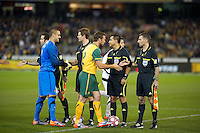 MELBOURNE, AUSTRALIA - MAY 24, 2010: Lucas Neill of the Qantas Socceroos shakes hands with the officials at the FIFA World Cup farewell match between Australia and New Zealand at the Melbourne Cricket Ground, 24 May, 2010 in Melbourne, Australia. Photo by Sydney Low / www.syd-low.com
