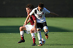 30 August 2013: Northeastern's Robbie Schallmo (10) and Elon's Mark Berlin (2). The Elon University Phoenix played the Northeastern University Huskies at Koskinen Stadium in Durham, NC in a 2013 NCAA Division I Men's Soccer match. The game ended in a 1-1 tie after two overtimes.