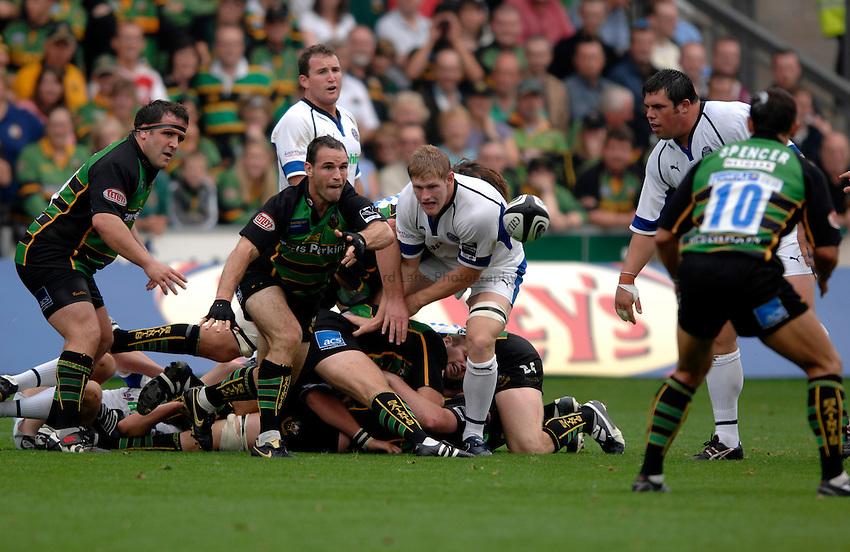 Photo: Richard Lane..Northampton Saints v Bath Rugby. Guinness Premiership. 16/09/2006. .Saints' Mark Robinson passes.