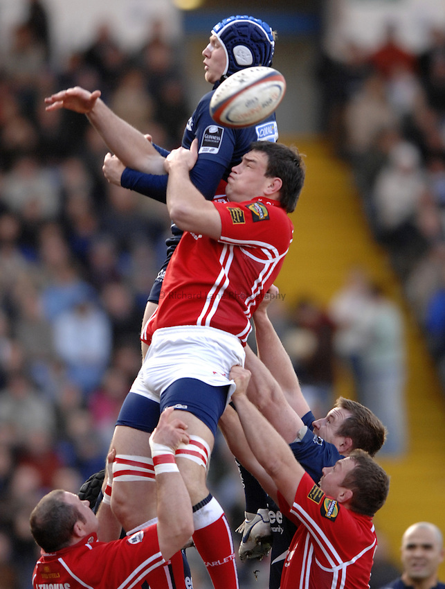 Photo: Richard Lane..Sale Sharks v Llanelli Scarlets. EDF Energy Anglo Welsh Cup. 02/12/2006. .Sale's Magnus Lund is challenged by Scarlets' Vernon Cooper at a lineout.