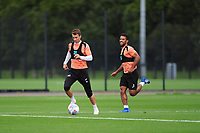 Tom Carroll vies for possession with Wayne Routledge of Swansea City during the Swansea City Training Session at The Fairwood Training Ground, Wales, UK. Tuesday 11th September 2018