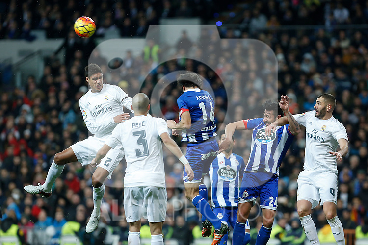 Real Madrid´s Raphael Varane and Karim Benzema and Deportivo de la Coruna´s Jonas during 2015/16 La Liga match between Real Madrid and Deportivo de la Coruna at Santiago Bernabeu stadium in Madrid, Spain. January 09, 2015. (ALTERPHOTOS/Victor Blanco)