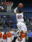 Bishop Gorman's Nick Blair slam dunks in the Division I NIAA state championship game against Canyon Springs at the Lawlor Events Center, in Reno, Nev., on Friday, Feb. 28, 2014. Bishop Gorman won the title 71-58. (Cathleen Allison/Las Vegas Review-Journal)