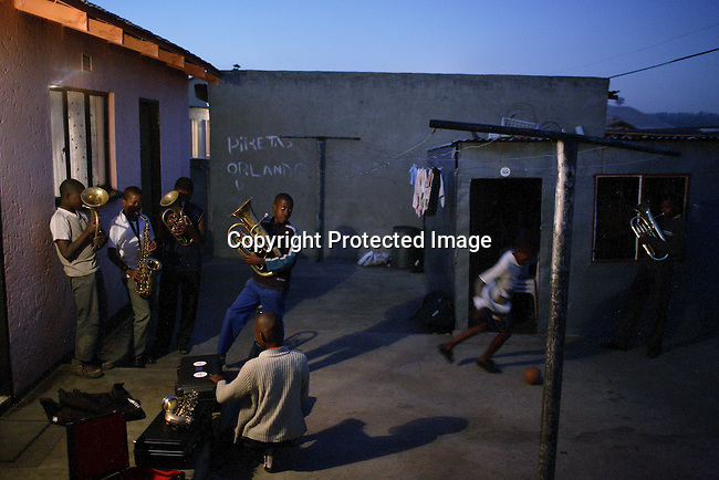 SOWETO,SOUTH AFRICA - OCTOBER10: Youth members of a Brass band rehearse in the back yard of a home in Soweto on October 10, 2007. (Photo by: Per-Anders Pettersson)