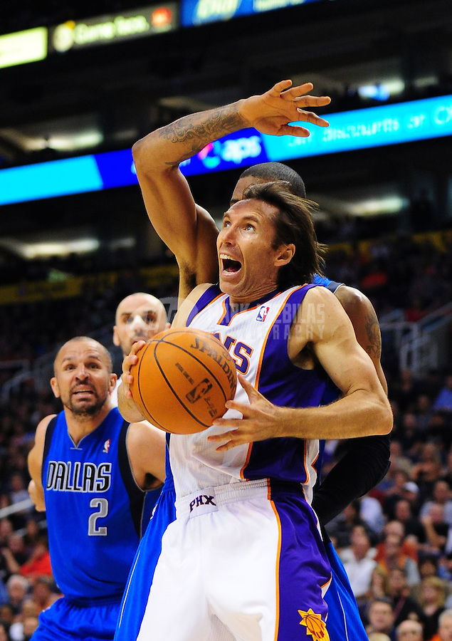 Mar. 27, 2011; Phoenix, AZ, USA; Phoenix Suns guard (13) Steve Nash attempts a shot under pressure from the Dallas Mavericks in the second half at the US Airways Center. The Maverick defeated the Suns 91-83. Mandatory Credit: Mark J. Rebilas-