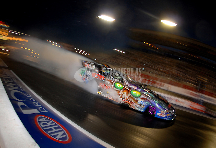 Apr 7, 2006; Las Vegas, NV, USA; NHRA Funny Car driver Mike Ashley does a burnout during qualifying for the Summitracing.com Nationals at Las Vegas Motor Speedway in Las Vegas, NV. Mandatory Credit: Mark J. Rebilas