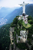 Rio de Janeiro, Brazil. The Christ Statue on the Corcovado mountain with tourists and the Tijuca Forest National Park below.
