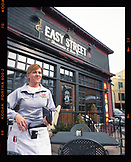 USA, Utah, Park City, a waitress serves tables at the Easy Street Brasserie and Bar
