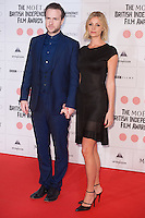 Rafe Spall and Elize du Toit arriving for the Moet British Independent Film Awards 2014, London. 07/12/2014 Picture by: Alexandra Glen / Featureflash