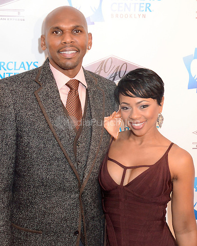 BROOKLYN, NY. - SEPTEMBER 27: Jerry Stackhouse and wife Ramirra Marks Stackhouse attending the Grand Opening of the 40/40 Club inside of the Barclays Center in Brooklyn New York on September 27th, 2012. © Laura Lewis / Starlite/MediaPunch Inc.