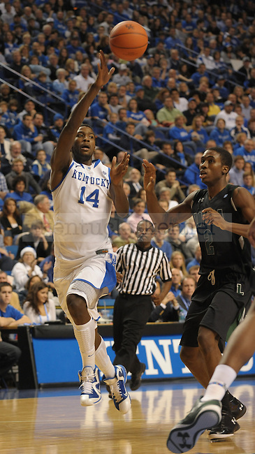 Michael Kidd-Gilchrist (14) makes a quick pass during the first half of the University of Kentucky Basketball game against Loyola at Rupp Arena in Lexington, Ky., on 12/22/11. UK won the game 87-63. Photo by Mike Weaver | Staff