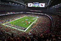 Arkansas Democrat-Gazette/BENJAMIN KRAIN --12/29/14--<br /> The Razorbacks take the field at the start of the Texas Bowl Monday night at NRG Stadium in Houston.