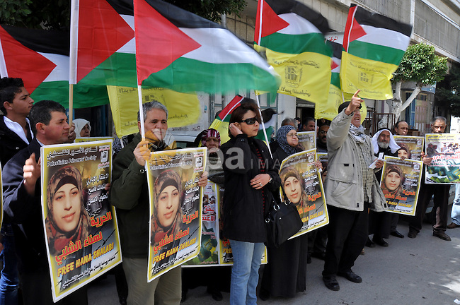 Palestinian women hold portraits of jailed compatriot Hana Shalabi, a female Palestinian prisoner jailed in Israel who has been on hunger strike for 33 days, outside the Red Cross building in the West Bank city of Nablus, 19 March 2012. Palestinian sources said that Shalabi is protesting against the Israeli administrative detention, which apparently is a law imposed against Palestinian prisoners under which they can be detained for months without a charge or trial.  Photo by Nedal Eshtayah
