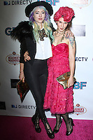 "HOLLYWOOD, CA - NOVEMBER 19: Kit Scarbo, Kat Turner arriving at the ""G.B.F."" Los Angeles Premiere held at the Chinese 6 Theater Hollywood on November 19, 2013 in Hollywood, California. (Photo by David Acosta/Celebrity Monitor)"