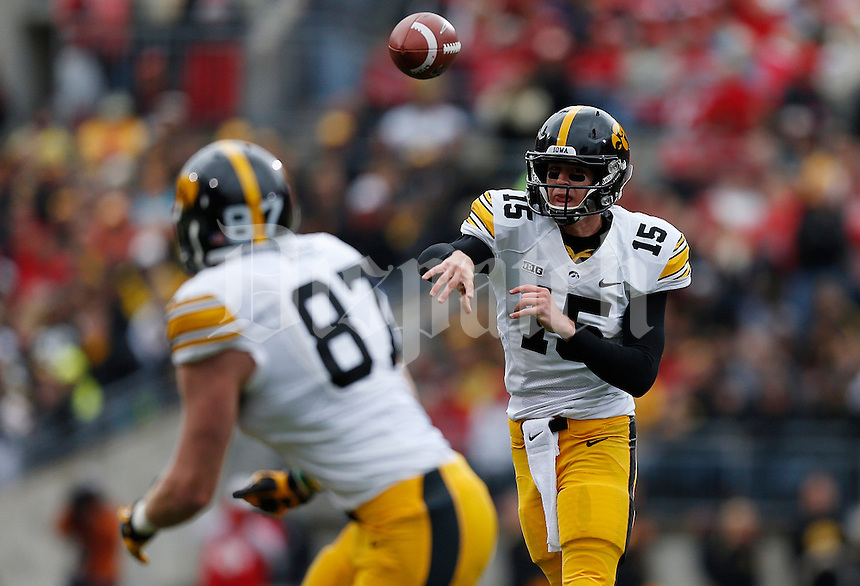 Iowa Hawkeyes quarterback Jake Rudock (15) tosses a short pass to Iowa Hawkeyes tight end Jake Duzey (87) in the first quarter of the NCAA football game between the Ohio State Buckeyes and the Iowa Hawkeyes at Ohio Stadium in Columbus, Saturday afternoon, October 19, 2013. The Ohio State Buckeyes defeated the Iowa Hawkeyes 34 - 24. (The Columbus Dispatch / Eamon Queeney)