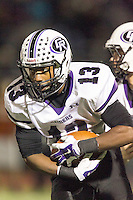 Cedar Ridge's Ron Dogan in action against Westwood Friday at Dragon Stadium.