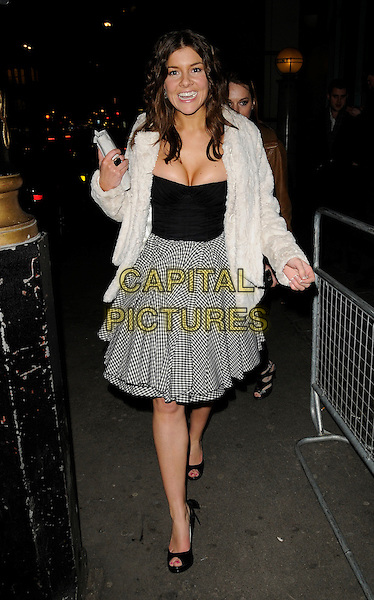 IMOGEN THOMAS .The Celebrity Agency Launch Party at Crystal Club, London, .January 29th 2009..full length white fur cream coat jacket black dress cleavage boobs top skirt gingham check checked open toe shoes .CAP/CAN.©Can Nguyen/Capital Pictures.