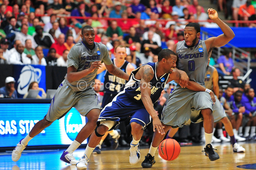 Mar 17, 2011; Tucson, AZ, USA; Utah State Aggies guard Brockeith Pane (3) tries to dribble part Kansas State Wildcats guard Jacob Pullen (0) in the first half of a game in the second round of the 2011 NCAA men's basketball tournament at the McKale Center.