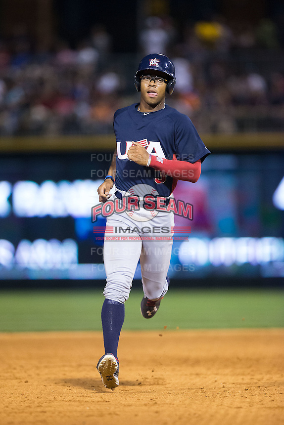 Buddy Reed (3) of the US Collegiate National Team rounds the bases against the Cuban National Team at BB&T BallPark on July 4, 2015 in Charlotte, North Carolina.  The United State Collegiate National Team defeated the Cuban National Team 11-1.  (Brian Westerholt/Four Seam Images)