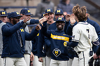 Michigan Wolverines outfielder Christian Bullock (5) greets teammate Jesse Franklin (7) after his first inning home run against the Indiana State Sycamores on April 10, 2019 in the NCAA baseball game at Ray Fisher Stadium in Ann Arbor, Michigan. Michigan defeated Indiana State 6-4. (Andrew Woolley/Four Seam Images)