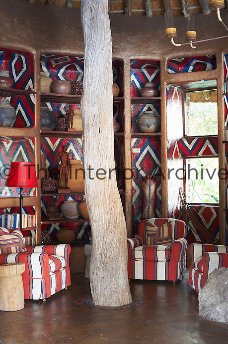 Seating with red and white patterned upholstery in a sitting area at the Singita Pamushana Lodge, Malilongwe Trust, Zimbabwe