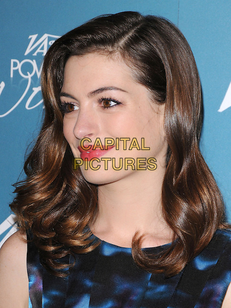 ANNE HATHAWAY .at the Variety 2nd Annual Power of Women Luncheon held at The Beverly Hills Hotel in Beverly Hills, California, USA, September 30th 2010..portrait headshot red lipstick make-up blue black print  beauty side profile .CAP/RKE/DVS.©DVS/RockinExposures/Capital Pictures.
