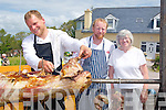 FOOD: Ryan Coote chef Stradbally) who cooks lamb on the bone on the spit at the Camp Sheeh Searing and Dog Trials on Sunday given Ryan a hand were Philip Edwards(Brandon) and mary Fitzgerald (Camp).......................