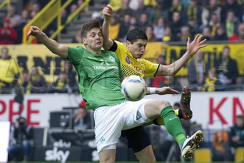 17 03 2012   Bundesliga 26 Matchday Borussia Dortmund versus Werder Bremen. Sebastian Proedl Prodl left HB against Robert Lewandowski Do
