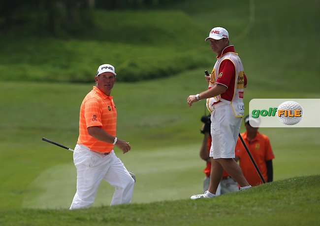 Lee Westwood (ENG) finds the fairway bunker on the last leading to a bogey and a finish on -14 during Round Three of the 2014 Maybank Malaysian Open at the Kuala Lumpur Golf & Country Club, Kuala Lumpur, Malaysia. Picture:  David Lloyd / www.golffile.ie