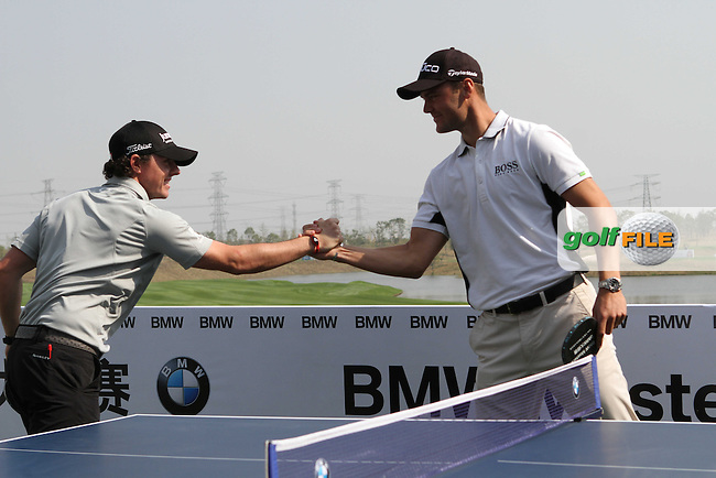 Rory McIlroy (NIR) with Martin Kaymer (GER) play table tennis ahead of the BMW Masters 2012 at Lake Malaren Golf Club, Shanghai, China, Tuesday 23/10/12...(Photo Jenny Matthews/www.golffile.ie)