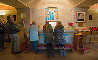 A group of visitors pray at the National Shrine of St. Katharine Drexel Thursday, December 28, 2017 in Bensalem, Pennsylvania. Drexel was an American heiress who dedicating herself to work among the American Indians and African-Americans in the western and southwestern United States. She was canonized a saint by the Roman Catholic Church in 2000. (Photo by William Thomas Cain/Cain Images)