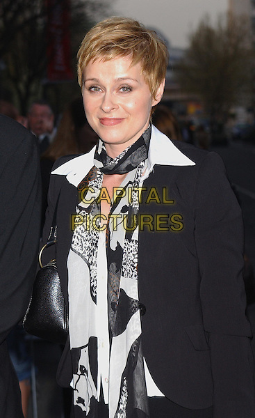 LISA STANSFIELD.At the opening of The Saatchi Gallery, County Hall, London..15th April 2003.half length, half-length, black and white top.www.capitalpictures.com.sales@capitalpictures.com.Supplied By Capital PIctures