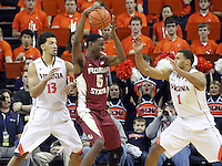 Florida State forward Jarquez Smith (5) is defended by Virginia forward Anthony Gill (13) and Virginia guard Justin Anderson (1) during the second half of an NCAA basketball game Saturday Jan. 18, 2014 in Charlottesville, VA. Virginia defeated Florida State 78-66. (AP Photo/Andrew Shurtleff)