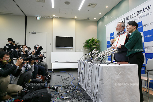 Professor Yoshinori Ohsumi (L) winner of the Nobel Prize in Physiology or Medicine 2016 holding his diploma poses for the cameras with his wife during a special press conference after arriving back to Tokyo International Airport on December 14, 2016, Tokyo, Japan. Ohsumi received a Nobel Medal, diploma and a document confirming the Nobel Prize from King Carl XVI Gustaf of Sweden during the award ceremony in Stockholm, Sweden on December 10. (Photo by Rodrigo Reyes Marin/AFLO)