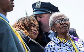 New York City Police officer Vincent Maher, hugs Genesis Villella, the daughter of slain police officer Miosotis Familia, who was killed in the line of duty, as President Donald Trump speaks about her, at the 37th Annual National Peace Officers' Memorial Service at the U.S. Capitol Building on May 15, 2018 in Washington, D.C.<br /> Credit: Kevin Dietsch / Pool via CNP