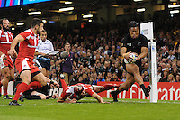Julian Savea of New Zealand brushes past Beka Tsiklauri of Georgia to score a try during Match 23 of the Rugby World Cup 2015 between New Zealand and Georgia - 02/10/2015 - Millennium Stadium, Cardiff<br /> Mandatory Credit: Rob Munro/Stewart Communications