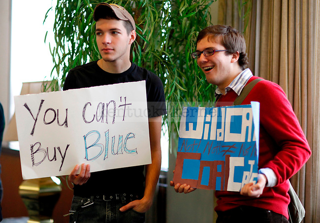 Political science sophomore Leo Weisberger,left, and History/Geography junior Watson Harding protest before the University of Kentucky Board of Trustees meeting Wednesday, October 27, 2009, to vote on a proposal to build a $7 million Wildcat Coal Lodge at the Patterson Office Tower..Photo by Zach Brake | Staff