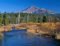 ORCAC_091 - USA, Oregon, Deschutes National Forest, South side of Broken Top rises beyond autumn-colored willows and grasses along Fall Creek.