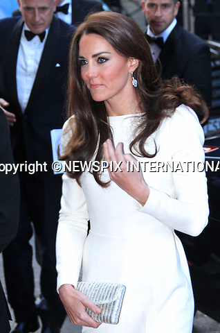 """PRINCE WILLIAM AND CATHERINE, Duchess of Cambridge.wearing in a full length cream outfit with a slit to the side, attend the Thirty Club Dinner at the Claridge's Hotel, London_08/05/2012.Mandatory Credit Photo: ©SB/NEWSPIX INTERNATIONAL..**ALL FEES PAYABLE TO: """"NEWSPIX INTERNATIONAL""""**..IMMEDIATE CONFIRMATION OF USAGE REQUIRED:.Newspix International, 31 Chinnery Hill, Bishop's Stortford, ENGLAND CM23 3PS.Tel:+441279 324672  ; Fax: +441279656877.Mobile:  07775681153.e-mail: info@newspixinternational.co.uk"""