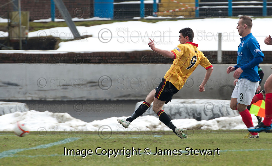 Thistle's Kris Doolan scores their first goal.
