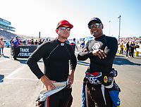 Jul 26, 2019; Sonoma, CA, USA; NHRA top fuel driver Steve Torrence (left) talks with Antron Brown during qualifying for the Sonoma Nationals at Sonoma Raceway. Mandatory Credit: Mark J. Rebilas-USA TODAY Sports