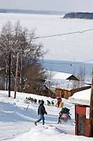 Mitch Seavey leaves the village checkpoint of Ruby towards the Yukon River in the distance during the 2010 Iditarod