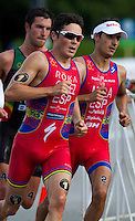 29 JUN 2014 - CHICAGO, USA - Javier Gomez (ESP) (centre) of Spain leads Mario Mola (right) also of Spain  and Joao Pereira (POR) (left) of Portugal during the run at the elite men's ITU 2014 World Triathlon Series round in Grant Park, Chicago in the USA (PHOTO COPYRIGHT © 2014 NIGEL FARROW, ALL RIGHTS RESERVED)