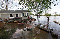 Ryan Hallam, left, and John Gamage sandbag the home at 1207 North Main Street in order to protect the home from four feet of Mississippi River floodwater in the Red Star District of Cape Girardeau, MO, on Thursday, April 28, 2011.