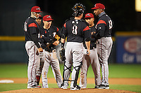 Richmond Flying Squirrels manager Jose Alguacil (13) makes a pitching change with (L-R) Myles Schroder, Rando Moreno, Kelby Tomlinson, Jackson Williams (8) and Ricky Oropesa during a game against the Erie Seawolves on May 19, 2015 at Jerry Uht Park in Erie, Pennsylvania.  Richmond defeated Erie 8-5.  (Mike Janes/Four Seam Images)