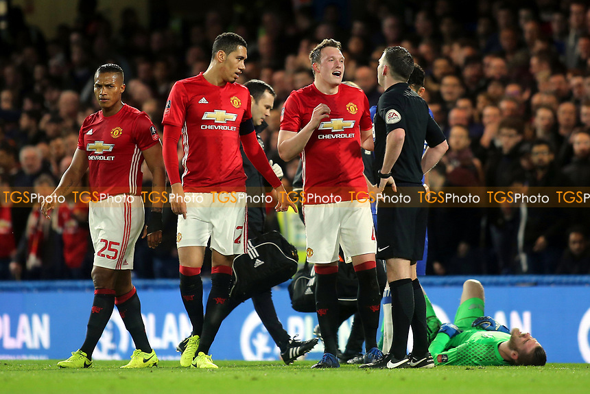 Manchester United's Phil Jones was not happy with referee, Michael Oliver, after a Chelsea challenge on goalkeeper, David De Gea went unpunished during Chelsea vs Manchester United, Emirates FA Cup Football at Stamford Bridge on 13th March 2017